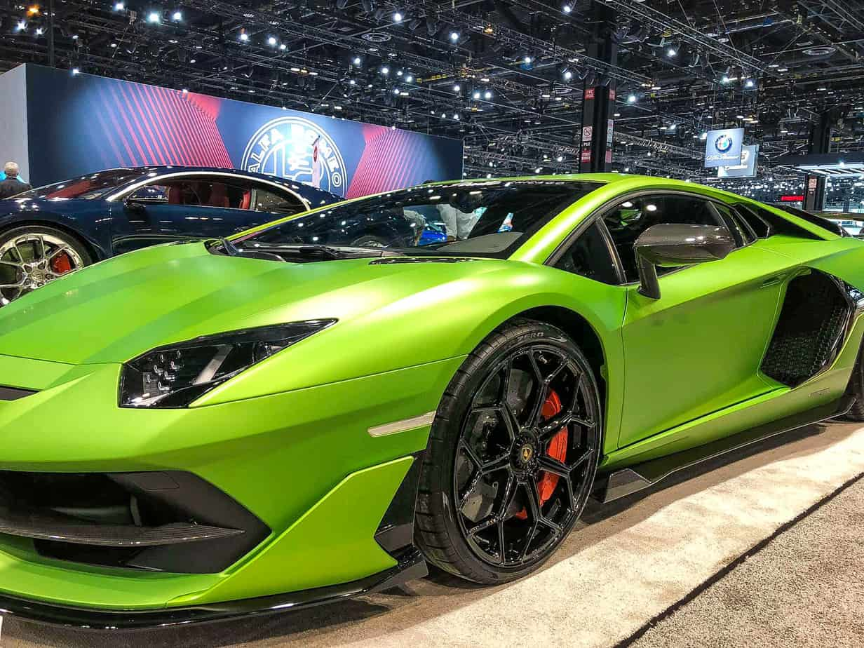 Green Lamborghini on an auto show floor